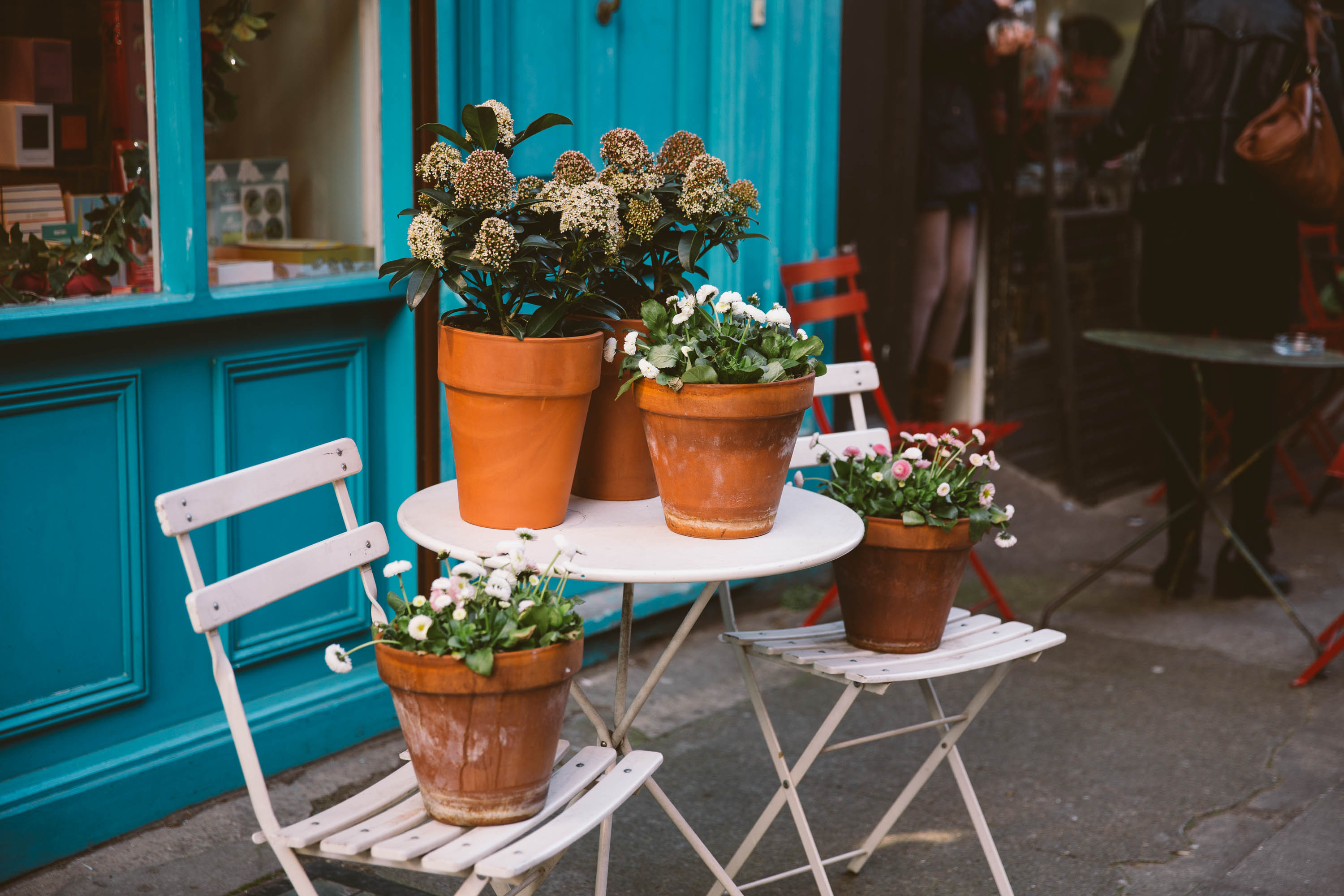 Plants on white outdoor furniture in Clerkenwell