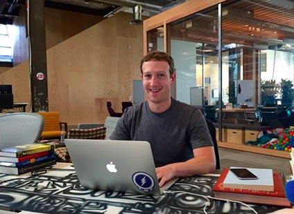 mark zuckerberg sitting at desk at facebook