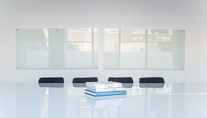 Corporate boardroom with four chairs
