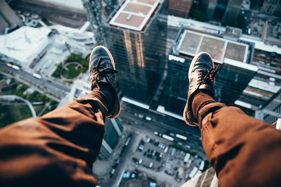 sitting on the edge of a building overlooking a city