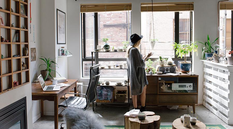 Girl in hat standing in studio space