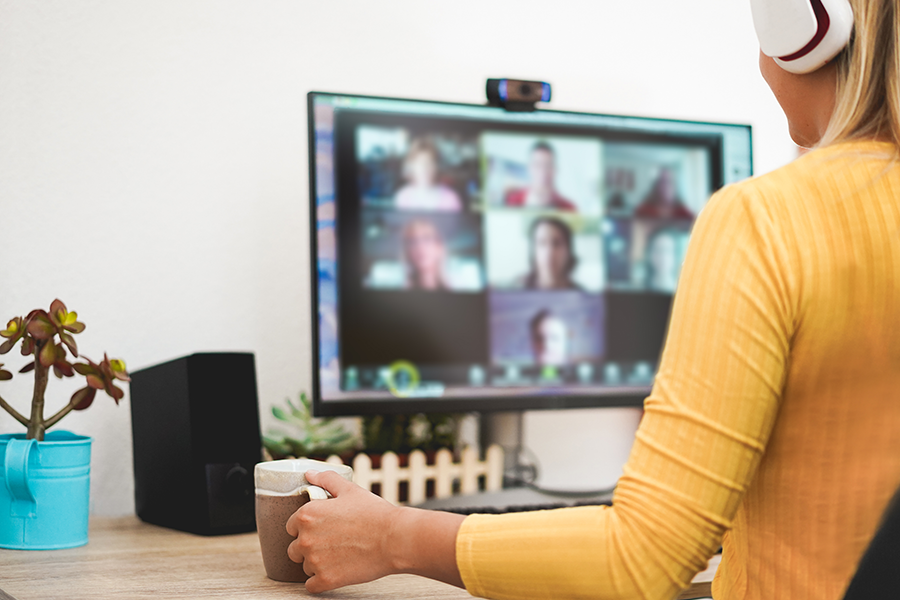 Woman in yellow shirt on a group video call